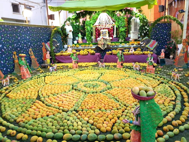 <p><em>The mango display at the temple</em></p>