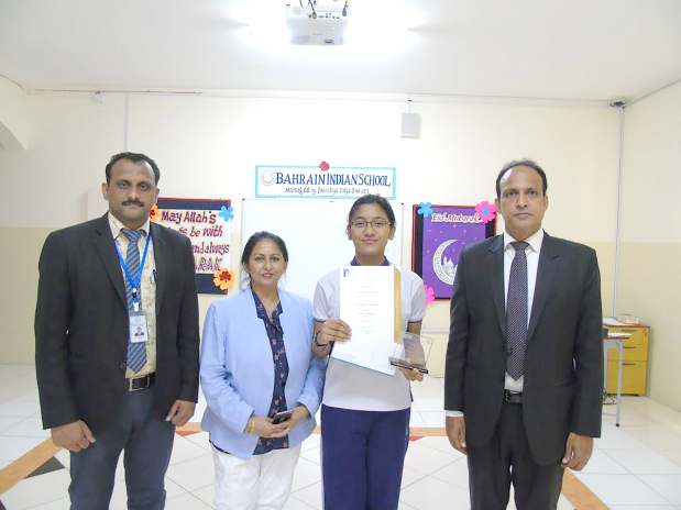 <p>Ritisha Bisht, a grade nine student of Bahrain Indian School – Bhavans was honoured for scoring the highest marks in Hindi as part of the International Benchmark Test. She was presented with a memento and cash prize by the Australian Council for Educational Research Limited, which conducted the test. At the presentation are, from left, Hindi teacher Ibrahim Gadkari, academic co-ordinator Dr Preet Kamal, Ritisha and school principal Saji Jacob.</p>