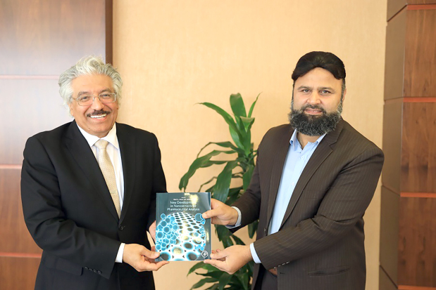 <p>Bahrain University president Dr Riyadh Hamza received College of Science chemistry department professor Dr Mohammed Afzal Shah who co-authored a book, New Developments in Nanosensors for Phamaceutical Analysis, along with Ankara University professor Dr Sibel Ozkan. Dr Hamza praised Dr Shah's efforts and underlined the importance of the book in helping raise the university's QS World ranking. Above, Dr Hamza, left, receives the book from Dr Shah.</p>