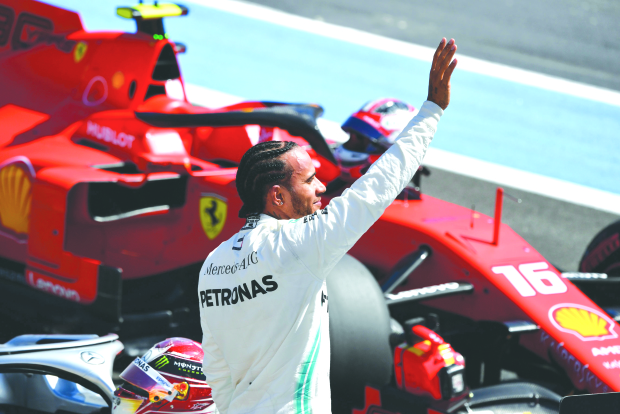 Hamilton surges to pole in style