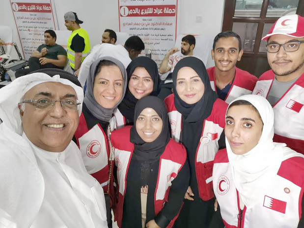 <p>A joint blood donation campaign brought together the Arad Village Charity Society, the Bahrain Red Crescent Society (BRCS) and the Health Ministry. Above, BRCS general secretary Dr Fawzi Amin, left, with volunteers at the event in Arad.</p>