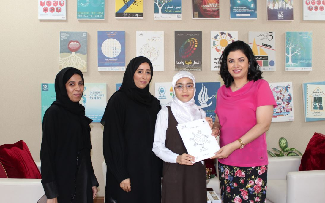 <div><i>Dr Sulaibeekh, right, receiving the book from Maram.</i></div>