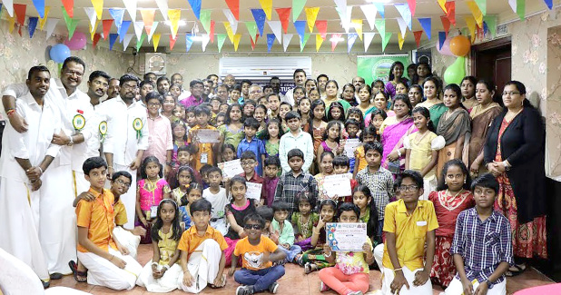 <p><em>Parents, children and society officials at the ceremony</em></p>