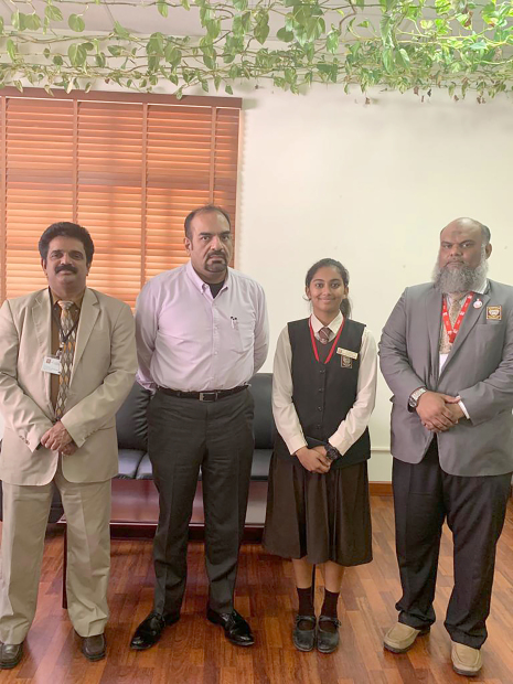 <div><i>Apourva with school officials who congratulated her on her achievement.</i></div>