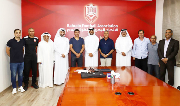 <p><i>Sousa, fifth from left, with Shaikh Khalid, centre, Ben Chammam, third from right, Paqueta, fifth from right, and other officials.</i></p>