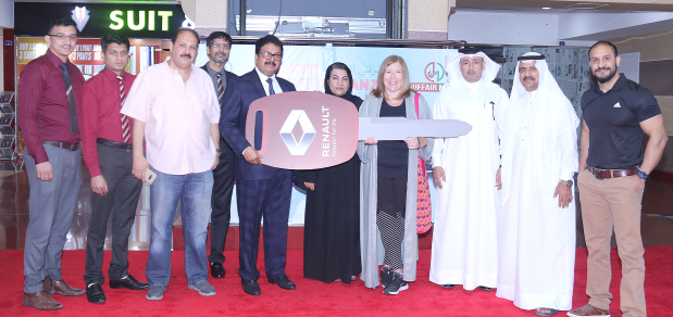 <p><i>Ms Page, fourth from right, with Mr Kurian, fourth from left, and other officials.</i></p>