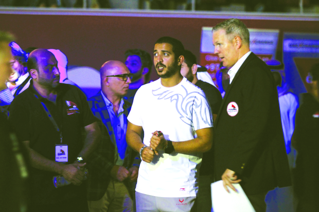<p><em>Shaikh Khalid at the event with other officials and action from one of the fights.&nbsp;Pictures by AHMED ALFARDAN</em></p>