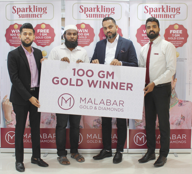<p><em>Mr Khadir, second from left, receiving his prize from Mr Rafeek, second from right</em></p> <p>The first raffle draw winner of Malabar Gold and Diamonds&rsquo; &lsquo;Sparkling Summer&rsquo; campaign is Abdul Khadir who received a 100gm gold bar from branch head Mohammed Rafeek in the presence of other officials.&nbsp;</p> <div>Under the campaign, which runs at all Malabar Gold and Diamonds outlets in Bahrain until July 13, customers receive one raffle coupon for every gold and diamond jewellery purchase worth BD50.&nbsp;</div> <div></div> <div>Customers also get 1gm gold coin on every BD300 worth diamond jewellery purchase.&nbsp;</div> <div></div> <div>There is also the chance to buy 8gm gold coins with absolutely no making charges during this period while customers can also avail of the zero deduction offer on 22K (GCC) gold jewellery exchange.&nbsp;</div> <p><em><br /></em></p>