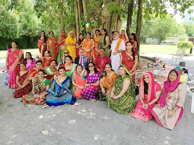 <p><em>Some of the women with Mr and Mrs Martin and temple priest Shastri Vijay Kumar</em></p>
