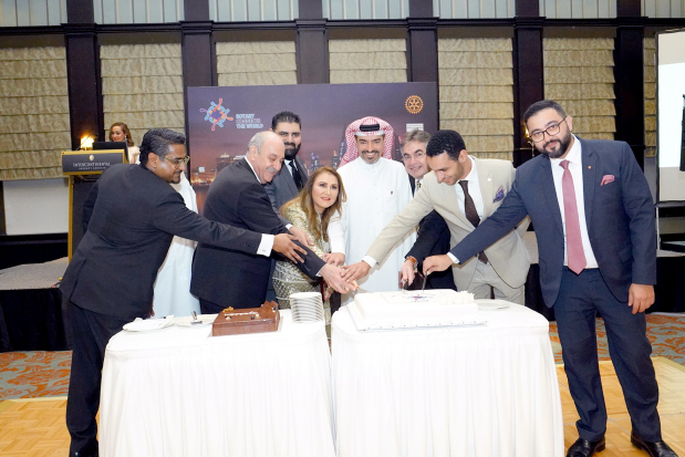 <p><em>The outgoing presidents with their successors cut a cake at the ceremony.</em></p> <p><em><br /></em></p> <p>The three Rotary clubs in the kingdom and the Rotaract Club of Bahrain held a presidents handover ceremony at the InterContinental Regency Bahrain.&nbsp;</p> <div>Ceremonial pins were handed over to incoming presidents who took office yesterday.</div> <div></div> <div>The clubs also pledged to fulfil Rotary International&rsquo;s theme for 2019-2020 which is &lsquo;Rotary Connects the World&rsquo;.&nbsp;</div>