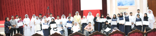 <p>An honouring ceremony for 205 outstanding graduates was held yesterday at the Education Ministry in Isa Town. The event, under the patronage of Education Minister Dr Majid Al Nuaimi, honoured 143 students from secondary schools, 39 pupils with various disabilities and 23 students from the technical stream. They received certificates and awards for their achievements from Dr Al Nuaimi. Above, Dr Al Nuaimi with graduates and ministry officials at the event.</p>