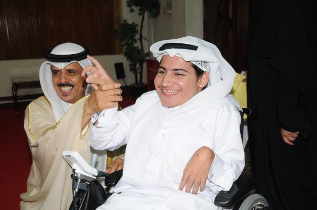 <p>Dr Al Nuaimi raising the hand of Bahraini graduate Mahmood Khamdan, who achieved 97pc GPA in a Kuwaiti secondary school.</p>