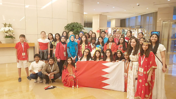 <p>Sixty-six British School of Bahrain (BSB) students took part in the global round of the World Scholar's Cup in Beijing. The students were part of a delegation of 22 teams in a competition that was attended by more than 220 schools. BSB head coach Yasin Motara received Coach of the Year award while the junior team, consisting of Lucy Hassett, Alma Mahmood and Luna Maronese, were crowned the best team in the Middle East and won the third place overall out of 600 teams. The senior team of Rose Basilious, Kaviesh Kinger and Syed Yousaf Kamran were placed third in the Middle East. Pratham Mehrotra and Kaviesh Kinger were also awarded the school top scholars for BSB in their respective divisions while 10 junior and three senior teams qualified for the Tournament of Champions to be held in November at Yale University in the US. Above, BSB students showcase Bahrain at the event.</p>