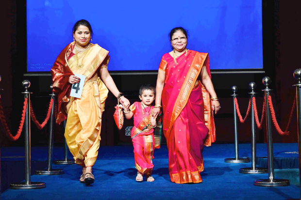 <p>Participants in 'Granny, Mom and Me' walk the ramp.</p>