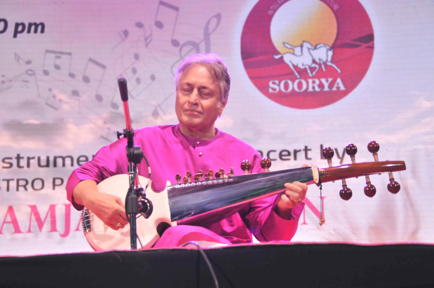 <p>A sarod concert by legendary Indian classical musician Amjad Ali Khan was held last night. The hour-long show held at the Bahrain Keraleeya Samajam (BKS) saw Mr Khan performing melodies including one inspired by the Arab style of music. Held as part of the BKS Business Icon Award 2019, presented to UNEECO chairman Abdulrahman Mohammed Juma, and Soorya Fest 2019, the event took place under the patronage of Electricity and Water Affairs Minister Dr Abdulhussain Mirza. Born into a musical family, Mr Khan is regarded as the world's finest sarod player and has performed internationally since the 1960s. The virtuoso known for his technical ability to play highly complex compositions on the sarod is also the recipient of India's second highest civilian honour Padma Vibhushan, in 2001. Above, Mr Khan performing at the event.</p>