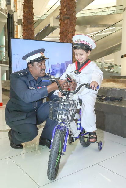 <p>The Southern Governorate yesterday held a security and social awareness exhibition at Enma Mall, Riffa. Children were briefed about the importance of wearing a seat-belt, avoiding mobile phones while driving, crossing the road safely, following traffic signals and obeying traffic rules. An awareness session was also held to highlight dangers of electronic games. The event aimed to boost community partnership with the General Directorate of Traffic and the General Directorate of Anti-Corruption and Economic and Electronic Security.</p>