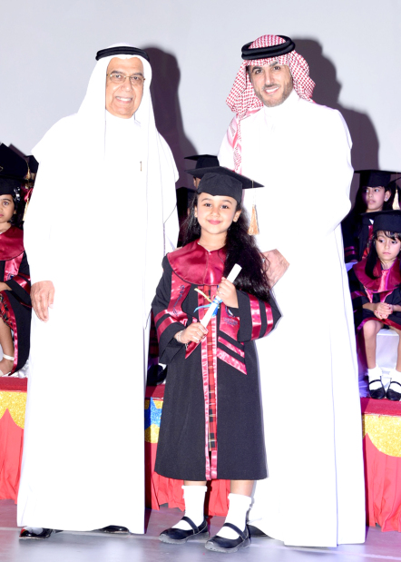 <p><em>From left, Mr Hasan and Mr Al Khayyat with one of the pupils</em></p>