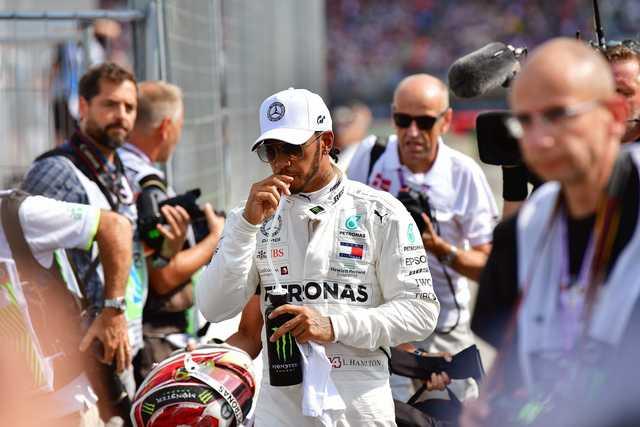 'Unwell' Hamilton takes German GP pole
