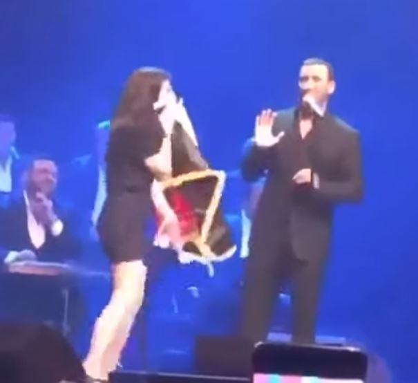 WATCH: Woman storms stage and disrupts Iraqi singer's live performance