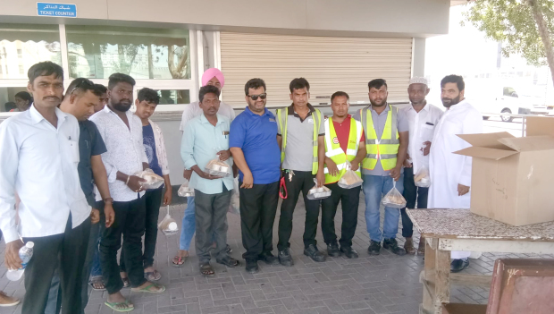 <p><em>Discover Islam volunteers with workers at one of the locations.</em></p> <p>More than 100 lunch packets were distributed to labourers as part of an initiative organised by Discover Islam in celebration of Eid Al Adha.</p> <p>The biryani packets were distributed to 150 workers in various areas across Bahrain such as Gudaibiya, Salmaniya and Salmabad.</p>