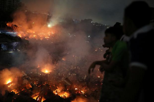 Dhaka slum fire leaves 50,000 homeless