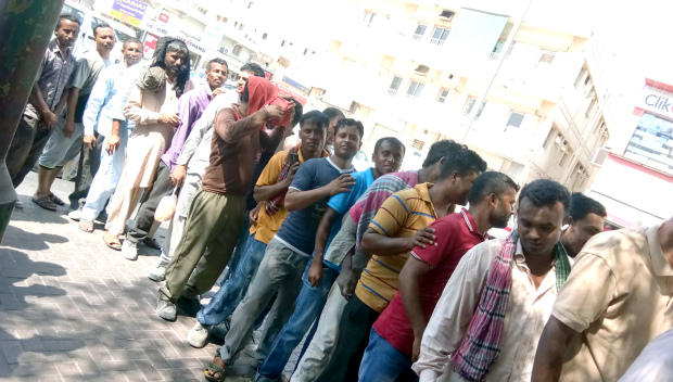<p><em>Workers lined up to receive their refreshment packets</em></p>