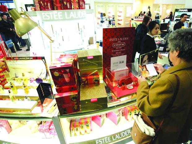 Estee Lauder raises earnings forecasts on robust demand