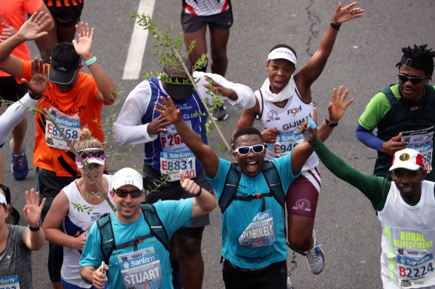 If marathons weren't hard enough already - strap a tree to your back and run