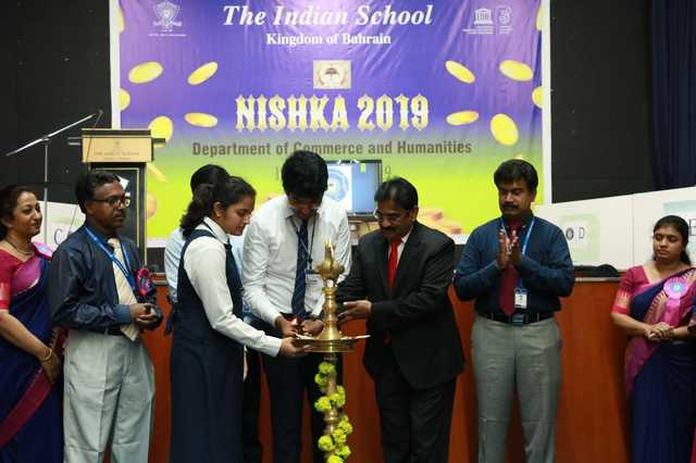 <p>Students from the Indian School Bahrain celebrated commerce day at the school grounds in Isa Town. The event, called Nishka 2019, involved students from grades 11 and 12 in the commerce and humanities fields, who took part in a number of activities and competitions. The event opened with the ceremonial lighting of the lamp by principal V R Palaniswamy and the inaugural address was delivered by senior section vice-principal Anand Nair. A prize distribution ceremony was also held and attended by chief guest YBA Kanoo business development manager Sarath Menon. Above, Mr Palaniswamy lights the lamp along with students and teachers.</p>