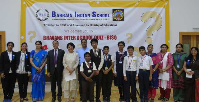 <p>A Gulf-wide online quiz for pupils studying in the Indian curriculum was hosted by the Bahrain Indian School (BIS) at its campus in Abu Saiba. Students from The Asian School Bahrain, Indian School Bahrain, New Indian School, New Millennium School-DPS, Ibn Al Hytham Islamic School and the BIS took part in the Bhavan&rsquo;s Inter-School Online Quiz-BISQ, competing with students of other Indian schools in the UAE and Kuwait. A total of 45 teams of three students each from grades six to eight took part in the hour-long quiz, which included 50 questions from various fields. The two best teams selected from Bahrain &ndash; the New Indian School and the Indian School &ndash; will compete in the grand finale on November 16. Above, BIS principal Saji Jacob, fourth from left, with BIS directors, student winners and faculty officials.</p>