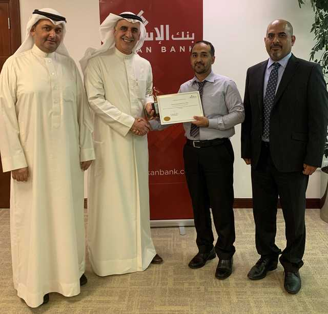 <p>Al Sayed Mahfoodh Kadhem has been named Eskan Bank&rsquo;s employee of the month. <br />Mr Kadhem, from the information technology department, was awarded for his outstanding performance and efficiency in accomplishing tasks. He was also recognised for his outstanding contribution to the implementation of the new banking system as well as the Value Added Tax system. Above, Eskan Bank general manager Dr Khalid Abdulla, second from left, presenting Mr Kadhem the certificate, in the presence of human resources, administration and corporate communications head Adnan Janahi, left.</p>