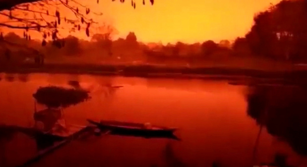 'This is earth not Mars': Blood red skies unsettle Indonesians