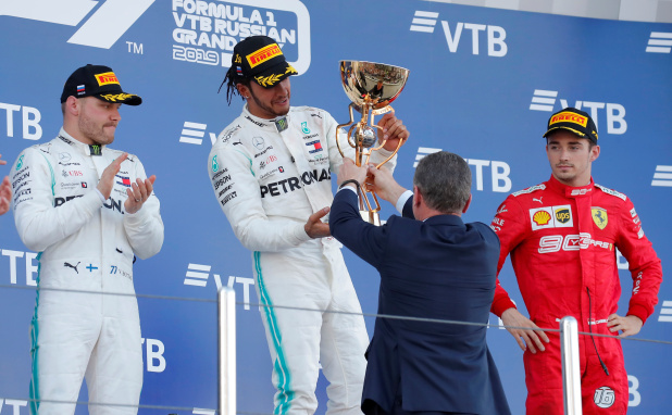 Russian GP: Hamilton wins as Ferrari trip on team orders