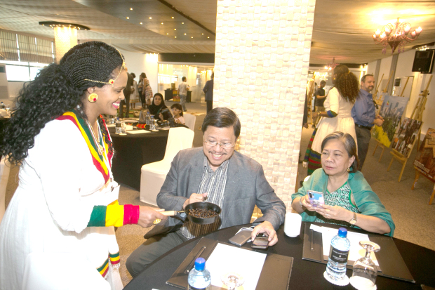 <p>A 'Discover Ethiopia' festival was hosted by the Ethiopian Honorary Consulate at the&nbsp; InterContinental Regency Bahrain. The event was attended by Ethiopian Embassy in Kuwait third secretary Martha Assefa and featured a live Ethiopian coffee ceremony, Ethiopian cuisine, and presentations on tourist attractions. Above, a demonstration of an Ethiopian coffee ceremony.</p>
