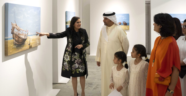 <p>An exhibition by artist Lamees Alhassar, titled 'Between Cities and Shores', opened last night at Studio 244, in Arad. The exhibition aims to spread Ms Alhassar's message of positive change, optimism and inner peace. Half of the proceeds from sales of her paintings will be donated to the Bahrain Association for Parents and Friends of the Disabled. Jointly hosted by the Bahrain Authority for Culture and Antiquities (Baca) and the Supreme Council for Environment (SCE), the exhibition is open to the public and will run until October 15, from 4pm to 8pm. Above, Ms Alhassar explaining her work to SCE chief executive Dr Mohammed Mubarak Bin Daina and Baca arts and culture director Shaikha Hala bint Mohammed Al Khalifa.&nbsp;</p>