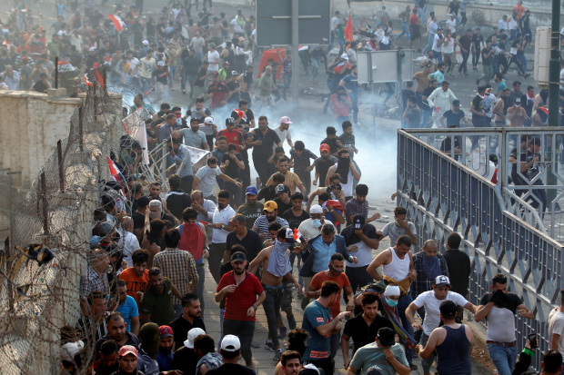 Two killed in Iraq clamp on protests