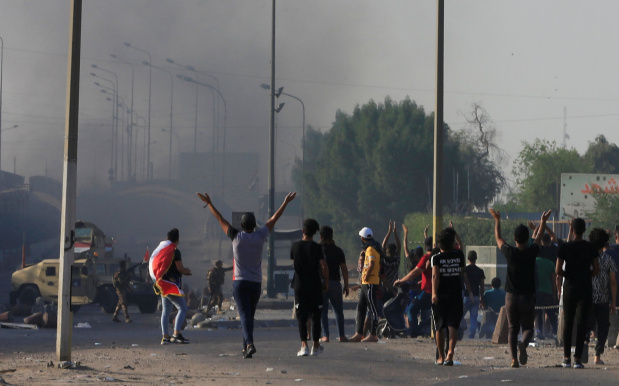 Police open fire on protesters in central Baghdad