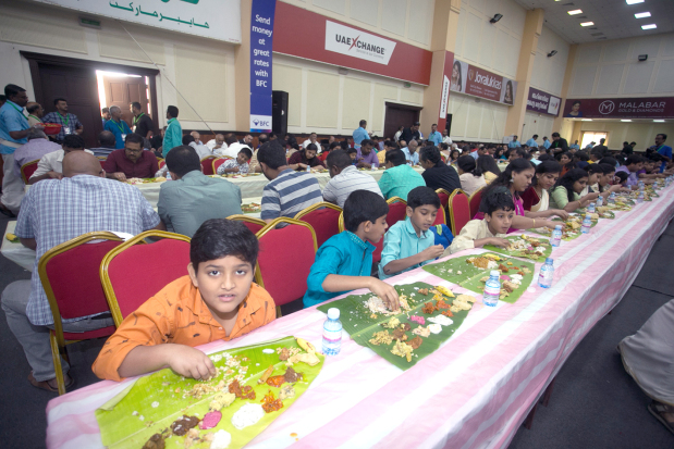 <p>Hundreds attended the traditional Onam feast, called Onasadya, yesterday at the Bahrain Keraleeya Samajam (BKS), Segaiya. It featured 33 traditional vegetarian dishes served on a banana leaf by more than 500 volunteers. BKS president P V Radhakrishna Pillai welcomed the guests. He thanked R P Group of Companies chairman Dr Ravi Pillai and other sponsors who supported the event. A total of 2,000kg of vegetables and 600kg of rice were brought in from Kerala for the occasion. Kerala's celebrity chef Pazhayidom Mohanan Namboothiri and his three-member team supervised the cooking. The event marked the culmination of the country's largest expatriate association's month-long Onam celebrations. Above, hundreds enjoyed the Onam feast.</p>