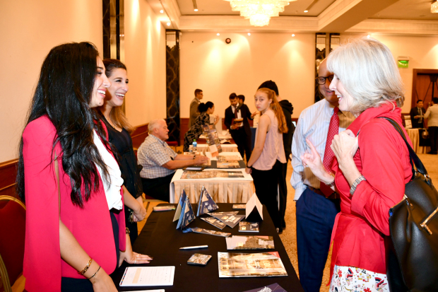 <p>More than 300 people attended the US Educational Group (USEG) Fall 2019 University Fair at the Sheraton Hotel Bahrain. Representatives from 40 American universities met students, parents and counsellors at the event inaugurated by US Embassy deputy chief of mission Margaret Nardi. Visitors were provided with information on academic programmes, financial aid opportunities, the admissions process and American campus life. Above, Ms Nardi, right, speaking to one of the representatives at the fair.</p>