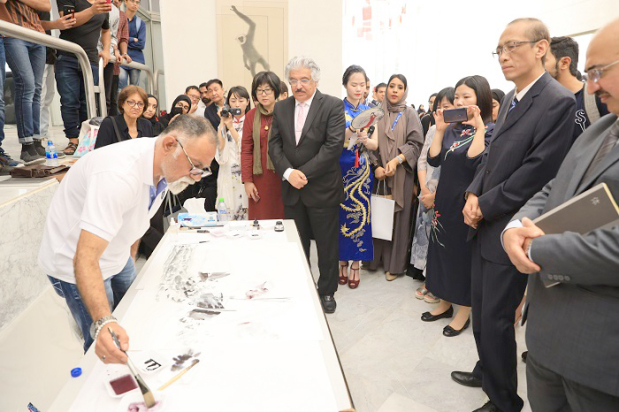 <p>Paintings depicting the beauty of China were on display at the Confucius Institute in Bahrain University's Sakhir campus. University president Dr Riyadh Hamza toured the exhibition which was by two visiting Chinese artists along with supporting artwork by five Bahraini artists. The institute opened in 2014 in collaboration with Shanghai University. Above, one of the Bahraini artists showcasing his artwork at the expo.</p>