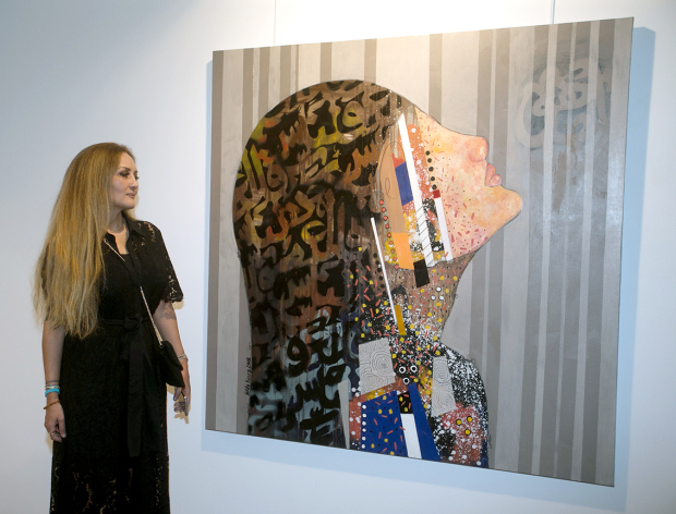 <p>An arts exhibition that highlights the plights of women in conflict zones opened last night at the Albareh Art Gallery, Adliya. </p><p>Jordanian artist Hilda Hiary opened her solo exhibition titled Women after War. It will run until October 28 at the gallery. </p><p>Above, Ms Hiary with one of her paintings.</p>