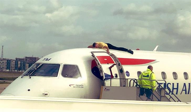 Climate protester lies on plane in disruption at London City airport