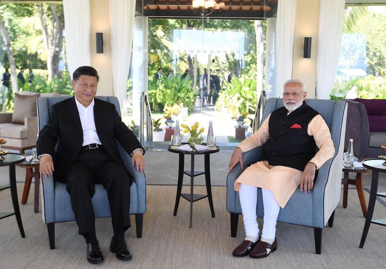 China's Xi says he will pursue proposals on bilateral ties discussed with India's Modi