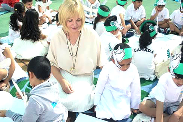 <p>Pupils from KG Kids pre-school celebrated International Day of Peace at their campus in Riffa. The campus was decorated in white as a symbol of peace and love and children sang songs in Arabic and English. The school's Arabic head teacher Sameera AlKabir gave a presentation encouraging peaceful attitudes and the event ended with school director Janet Lanceley setting a white dove free. Above, Ms Lanceley along with pupils at the event.</p>