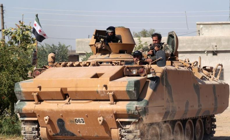 Forces advance into key Syrian town