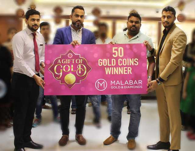 <p>Nikesh V K is the winner of Malabar Gold and Diamonds&rsquo; (MGD) &lsquo;Gift of Gold&rsquo; campaign.</p> <p>He won 50 gold coins as part of the campaign where customers could win a guaranteed gold coin or up to 50 gold coins instantly on purchase of gold jewellery worth BD300 via scratch and win coupons.</p> <p>Above, MGD branch head Mohammed Rafeeq, second from left, hands over the prize to Mr Nikesh in the presence of other staff members</p>