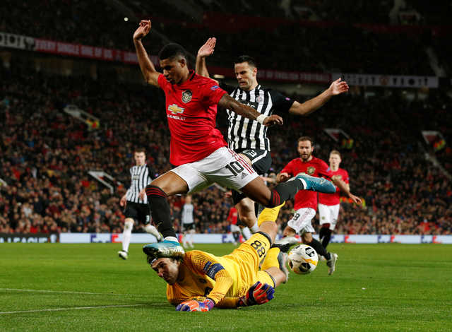 Europa League: Manchester United brush Partizan aside to reach last 32