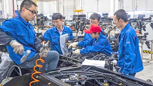 China's November factory activity returns to growth