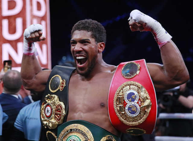 Joshua takes back heavyweight titles on unanimous points decision