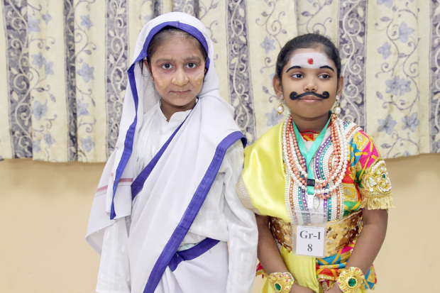 Two children dressed up as part of the festival